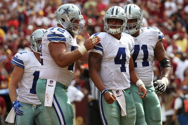 La'el Collins Photos Photos - Quarterback Dak Prescott #4 of the Dallas Cowboys celebrates with teammates center Travis Frederick #72 and offensive guard La'el Collins #71 after scoring a third quarter touchdown against the Washington Redskins at FedExField on September 18, 2016 in Landover, Maryland. - Dallas Cowboys v Washington Redskins