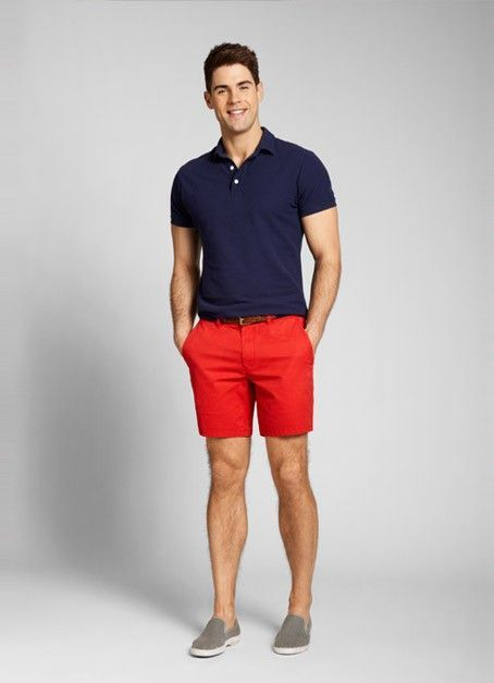 Make a dark blue polo and red shorts your outfit choice to get a laid-back yet stylish look. A pair of grey slip-on sneakers will seamlessly integrate within a variety of outfits.   Shop this look on Lookastic: https://lookastic.com/men/looks/navy-polo-red-shorts-grey-slip-on-sneakers-dark-brown-belt/11593   — Navy Polo  — Dark Brown Leather Belt  — Red Shorts  — Grey Slip-on Sneakers