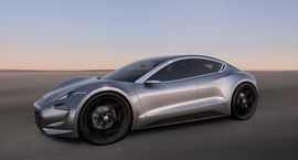 The Fisker EMotion promises 400 miles of EV range mid-2017 arrival     - Roadshow  Roadshow  News  Sedans  The Fisker EMotion promises 400 miles of EV range mid-2017 arrival  Enlarge Image  Those fenders are so exaggerated that the whole cabin looks tiny by comparison.                                             Fisker Inc.                                          Henrik Fisker designer of some very pretty cars like the BMW Z8 slowly teased his latest creation over the last few weeks. Now…