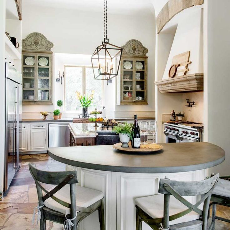 Hacienda style kitchen walls and cabinets painted white in ...