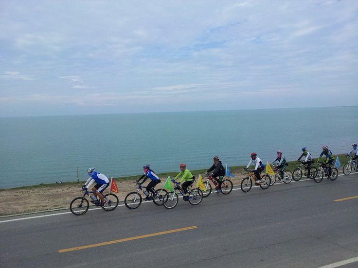 riding bicycle around the qinghai lake Cycling around the Qinghai Lake of China