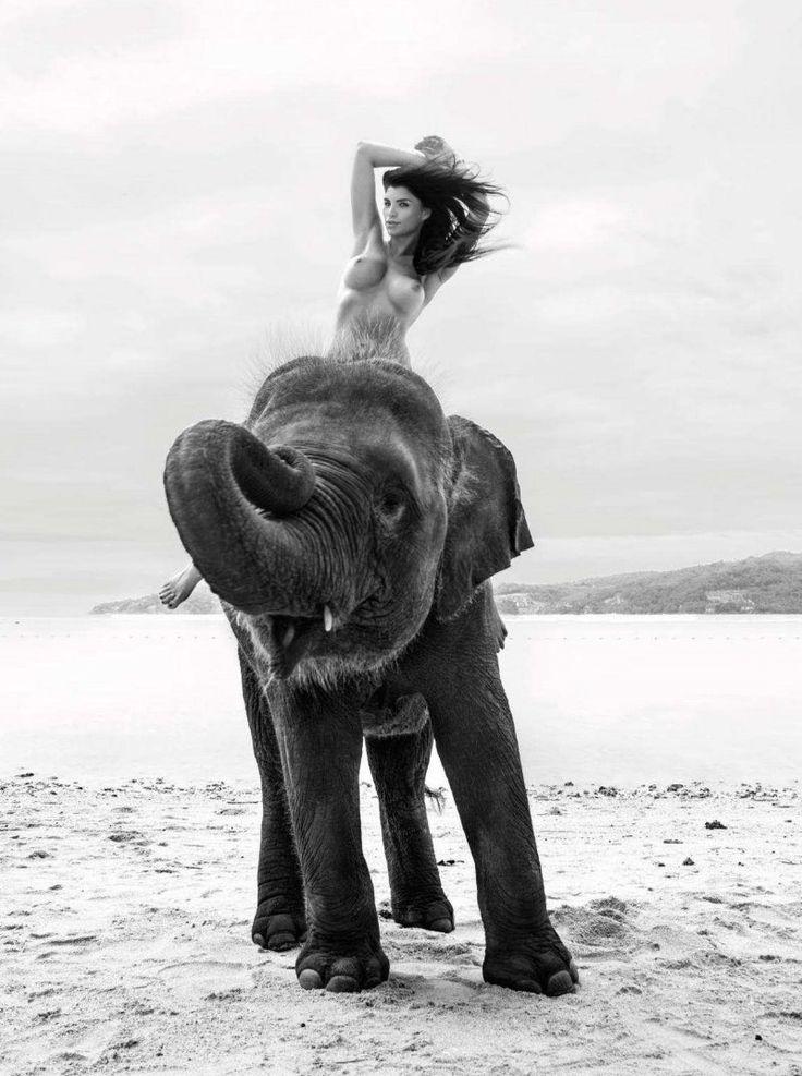 nude-woman-riding-elephant