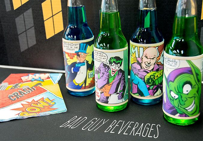 Superheroes vs. Villains Halloween Party Theme. Make copies of vintage comic book pages to create fun bottle wraps. #partyideas #Halloween #OrangeTuesday