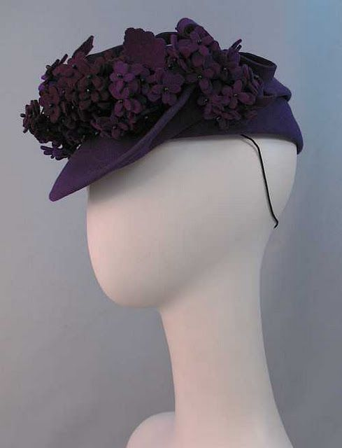 felt flower tilt hat. Clear picture. Can see how base works and the additional fastenings.