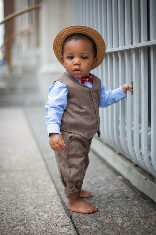 Cute. But at what point are we letting kids not be kids? Run around play in the dirty.  Kids should be comfortable enough in what their wearing to be able to have fun.  Is a 3 piece suit allowing this little boy to do that?