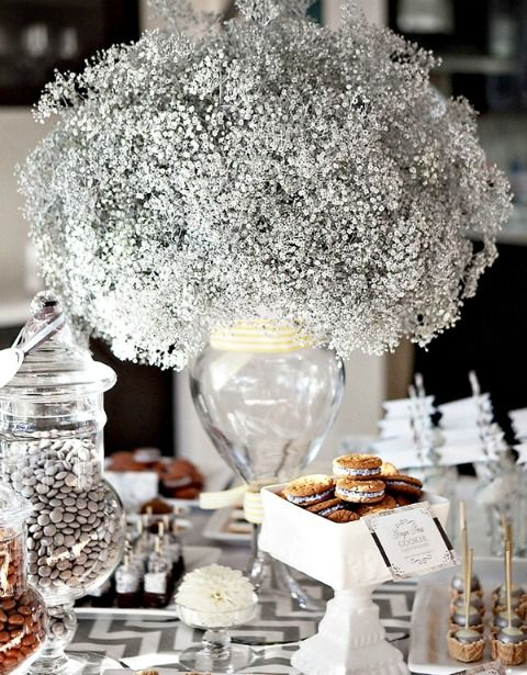Baby's Breath spray-painted silver for decor for the guest book table or dessert tables with tall solid vases.