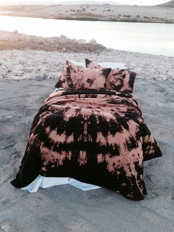 This reverse-dyed duvet set was inspired by an aerial view of a ground explosion. Layers of black, bronze, and variations of orange ranging from