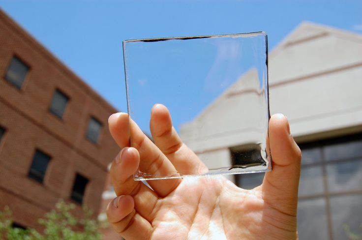 Solar power with a view: MSU doctoral student Yimu Zhao holds up a transparent luminescent solar concentrator module.