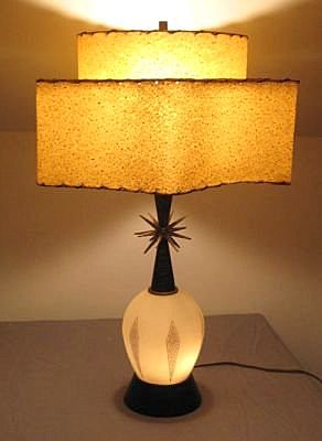 mid century lamp with lit base and interesting shaped two tiered shade. I love the little atomic whatchamacallit on the base, too.