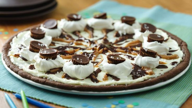 Looking for a sweet treat? Turn Pillsbury® sugar cookies into a dessert pizza topped with whipped topping and candies – perfect for birthday celebration.
