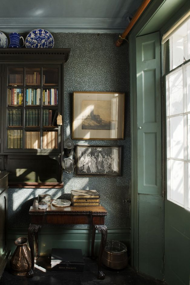 The Dining Room of The Emery Walker House with original Morris & Co 'Willow Bough' wallpaper and Philip Webb designed bookcase.