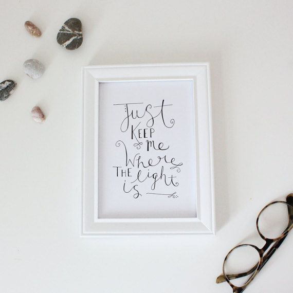 Art print with hand-lettered design Includes the text, Just keep me where the light is. (from the song Gravity by John Mayer) Text is black, Printed on 110lb cardstock paper Tangible print that can be shipped in 5x7 or 8x10 dimensions Can be put into a frame, hung on the wall with washi tape, or given to a friend :)
