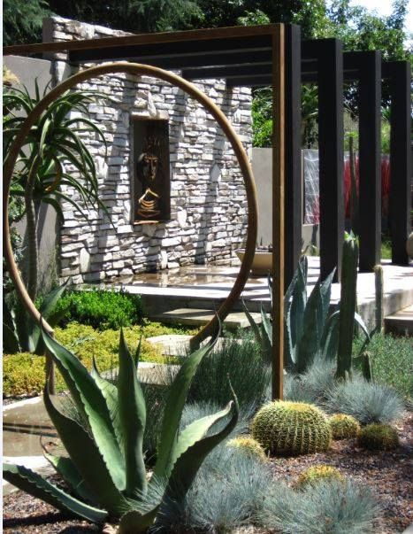 Contemporary water wise garden, with modern steel Moon Gate