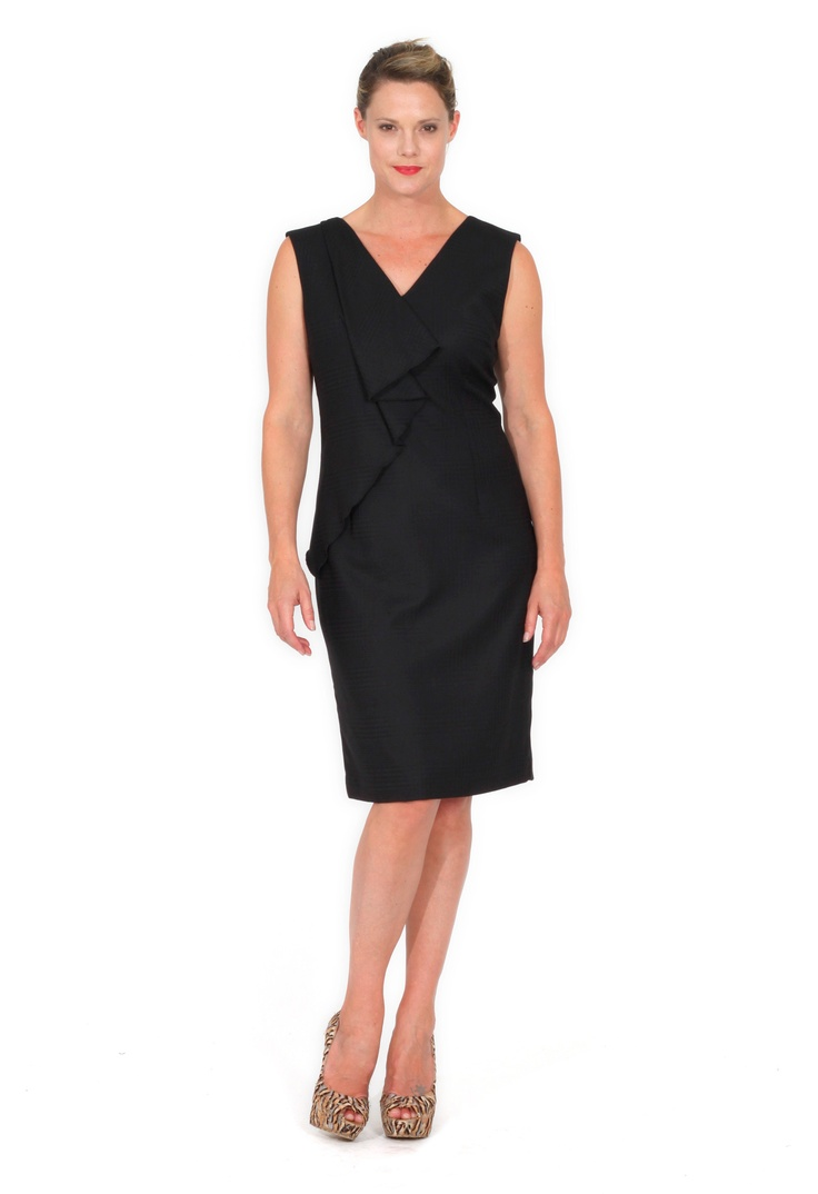 Redhead Office - Waterfall Front Dress. This beautiful little Black dress is in a soft self check fabric. The Asymmetrical waterfall frill falls across the front of the dress giving the style a flattering feminine detail. This dress is fully lined.