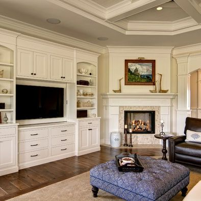 Built in entertainment center with corner fireplace...but of course not in white and the fireplace will be stone!