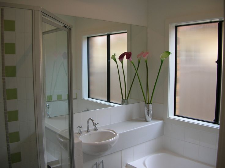 Semi-recessed basin in long bench with full-length mirror over