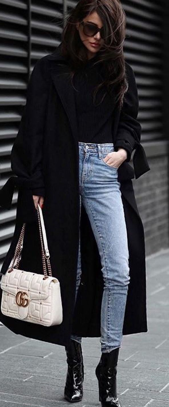 Black top light jeans black duster coat black patent leather boots    Fall spring