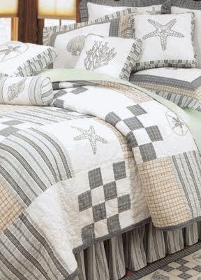 coastal bedding in neutral colors | or create a sea environment with cozy quilts in neutral gray...