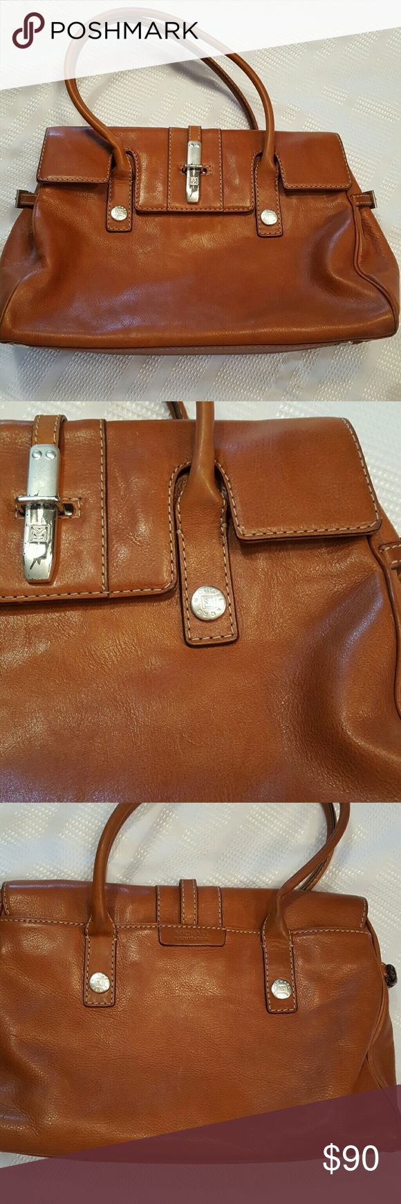 "VINTAGEMichael Kors Leather Shoulder Bag Gorgeous Tan/Brown Supple Leather Purse from Michael Kors.  Authentic and leather us gorgeous.  EUC overall. A few minor marks on the leather but barely noticeable.  Metal sliding clasp has tarnish. That is where the ""wear"" is.  Inside is a gorgeous linen lining in perfect shape.  3 sections, one zippered and Interior zipper pocket. 1 outer pocket.  Smoke free, pet free home. 6in strap drop.  Adjustable buckles on sides. Michael Kors Bags"
