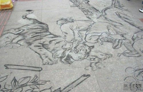 Chalk Drawings of a one-legged beggar in China