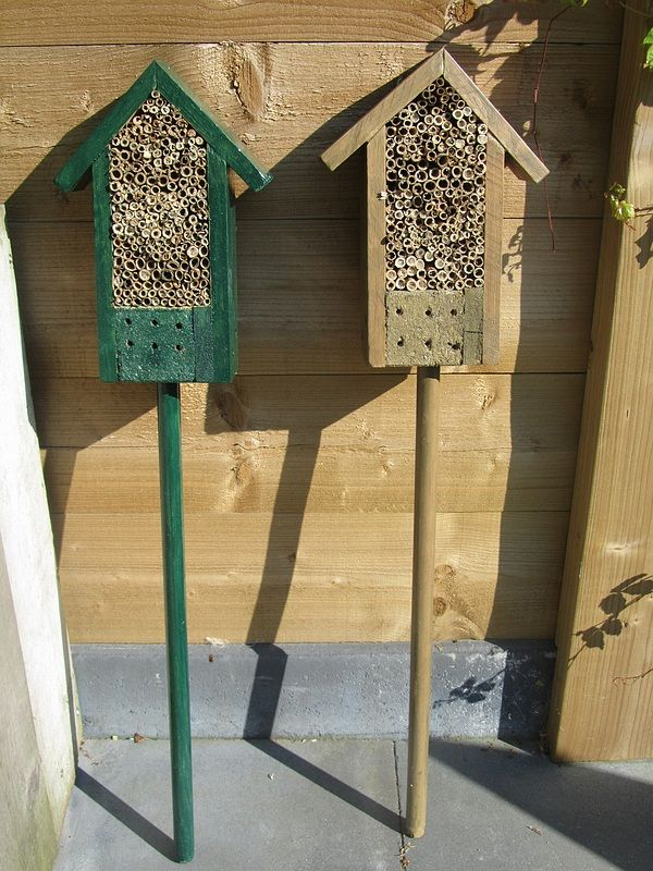 insect hotel on a pallet and an old broomstick. With reeds in it for ladybugs
