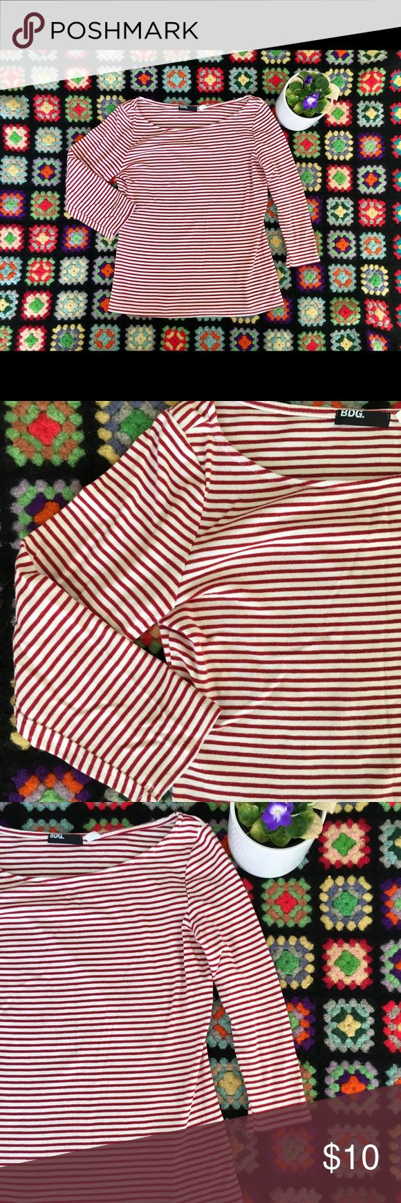 Urban Outfitters striped top Bdg urban Outfitters  Size medium Made in USA Red and white striped blouse. Simple and chic. Very feminine chic looking. Great condition. Three quarter sleeves. Urban Outfitters Tops Blouses