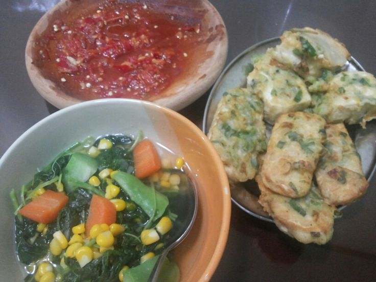 Spinach soup, sambal (traditional chilli sauce), and fried tempe-tofu