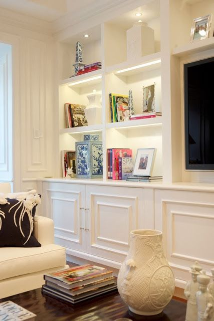 These built-in shelves are perfect for displaying books and art. Accent lights make them the focal point of the room. Find the perfect home for you at http://www.dongardner.com/. #Built-In #Shelves #Design