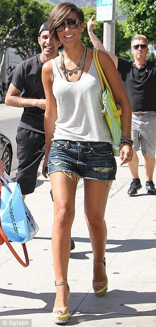 Showing off her enviable legs: Frankie wore a white vest top with denim shorts and wedges