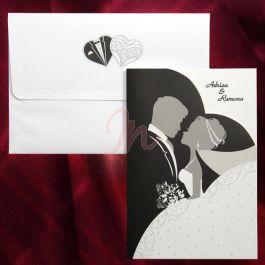 Invitatia are la baza culorile alb, negru si gri, care sugereaza eleganta. In centru observam un desen stilizat cu cei doi miri iar in partea dreapta sus se poate tipari numele celor doi miri (initialele). Plicul, avand inserate doua inimioare stilizate, este inclus in pret. #invitatie de #nunta #mirese #miri #invitatii #elegante #originale