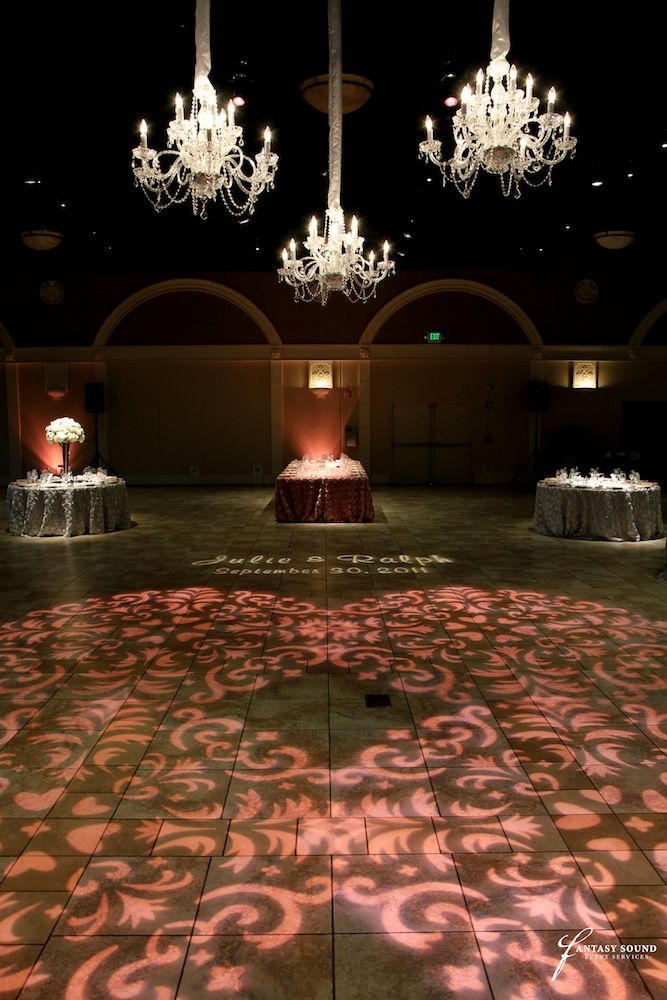 pink gobo washes  a custom monogram  and chandeliers at casa real on pinterest