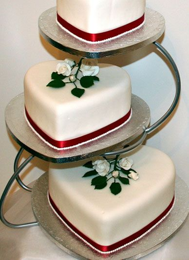 3 Tier Heart Shaped Wedding Cake ....I love this idea!! I would use different colors for the ribbon and different toppers as well.  Maybe I could put my husband and I on the top then the other bridal party members on the other tiers
