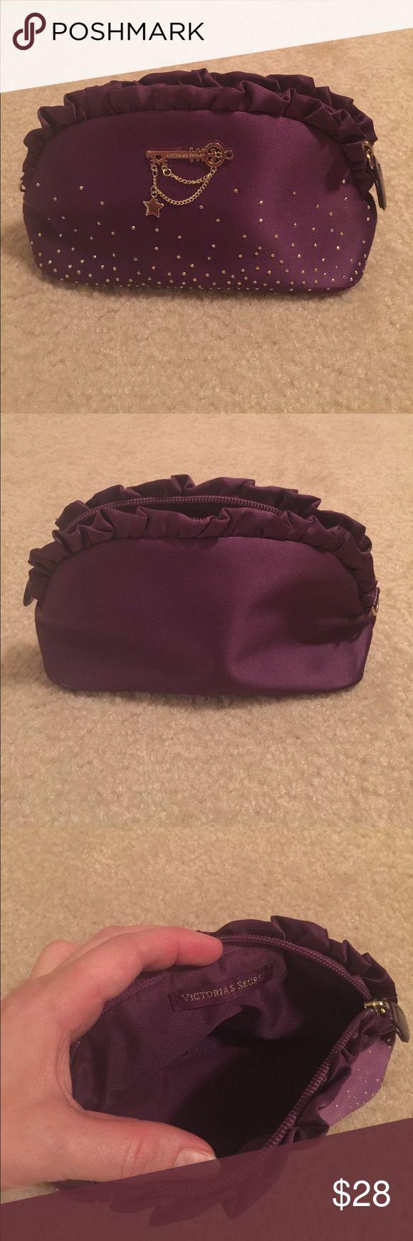 Victoria's Secret purple clutch bag Victoria's Secret purple clutch or makeup bag with gold details. Used twice. No marks or dirt. Victoria's Secret Bags Clutches & Wristlets