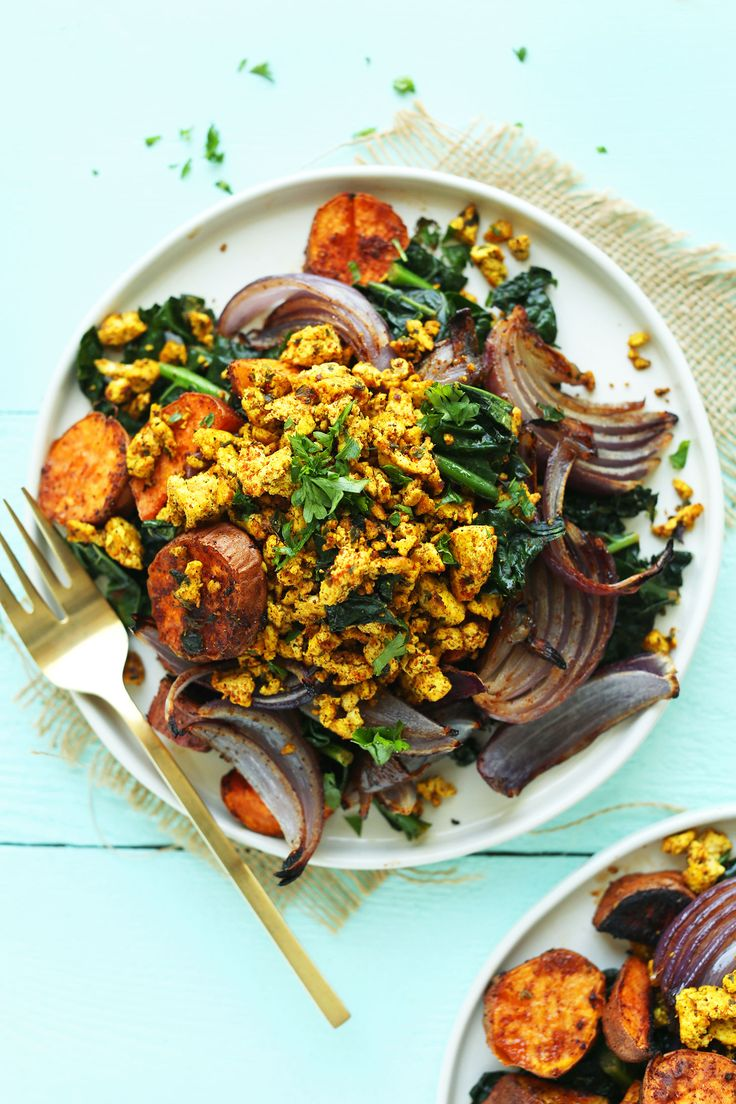 Flavorful, healthy breakfast hash with roasted sweet potatoes, red onion, kale, and masala-spiced tofu! A protein- and fiber-packed plant-based meal.