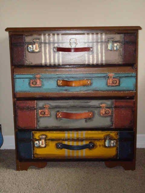 Look! It is a dresser PAINTED to look like a stack of suitcases.