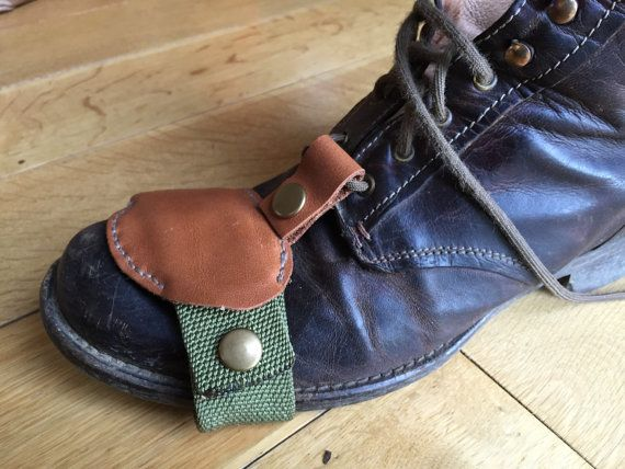 Hand made hand stitched British Leather cafe racer boot toe protector.  Protect any boot you wear on a motorcycle when changing gear. Hard wearing. Three layers of leather glued and stitched together over canvas style strap. Secured with heavy duty brass poppers.