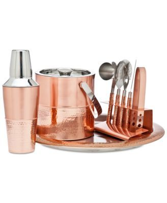 The sleek copper-tone stainless steel of this bar set from Godinger brings a modern update to your barware.   Stainless steel   Hand wash   Imported   Stainless Steel   Imported   All dimensions liste