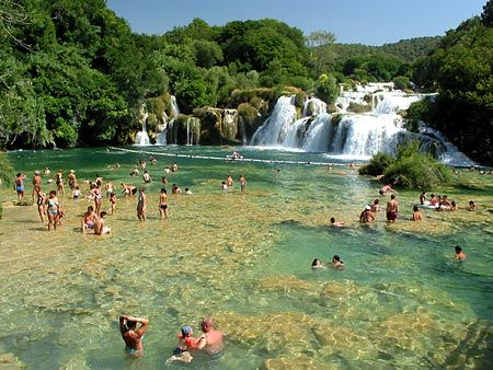 Dalmatia, Croatia - Swimming under the falls of Krka National Park