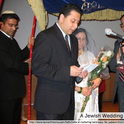 A Popular Tradition In Jewish Wedding Is When The Friends Lift Groom Up On Chair As His Dance To Music And Raised Lowered Him