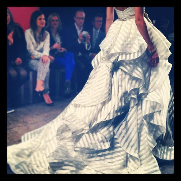 the back of a striped wedding dress at jlm click for more from this show