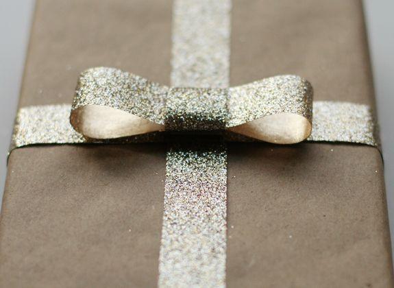 Beautiful wrapping using basic kraft paper and a strand of glitter ribbon...adore!