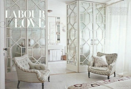 Wallpaper and textiles designer, Neisha Crossland's master bathroom in her London home. Spectacular details like the fretwork screens leading from her master bedroom into her bathroom.