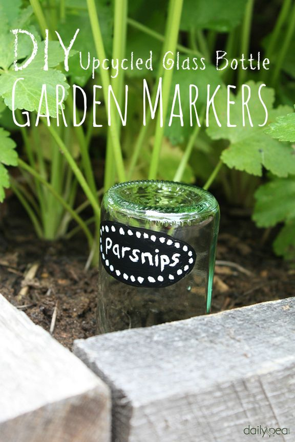 DIY Upcycled Glass Bottle Garden Markers - Before you toss your glass bottles into the recycling bin, check out how pretty and functional they are in the garden…