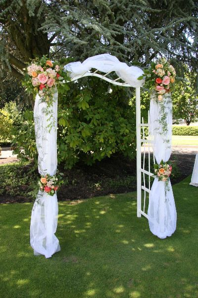 304 best wedding arches possibilities images on pinterest wedding create a picture perfect backdrop for an outdoor wedding with an arch draped in tulle and accented with a beautiful mix of flowers junglespirit Image collections