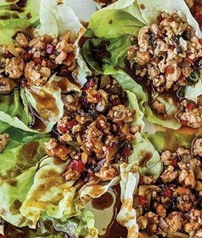 This is Chrissy Teigen's go-to healthy chicken in lettuce cups recipe | Health.com
