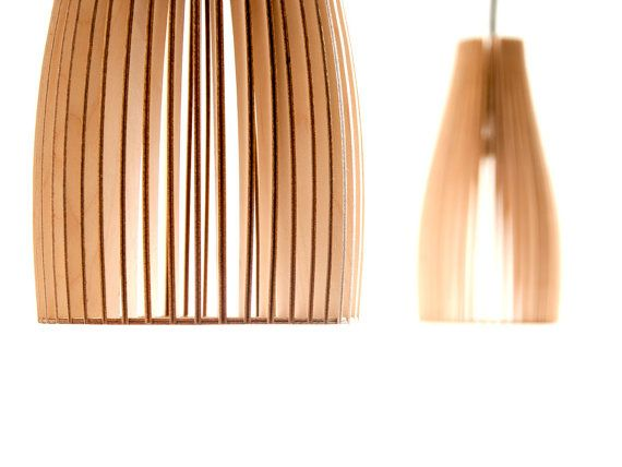 ENA is a wooden pendant lamp by IUMI. Its simple and slim shape makes it the ideal light for dining tables. ENAs spotted light creates a warm and ambient atmosphere. Availbale in six colors and two sizes. More infos at iumi.de  $120