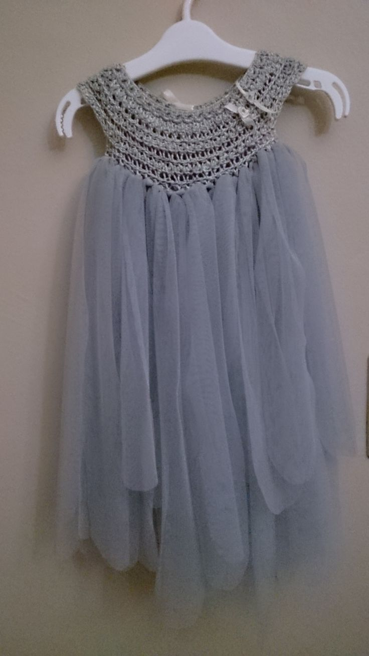 Beautifully handmade crochet yarn and voile little girl dresses for special occasions.