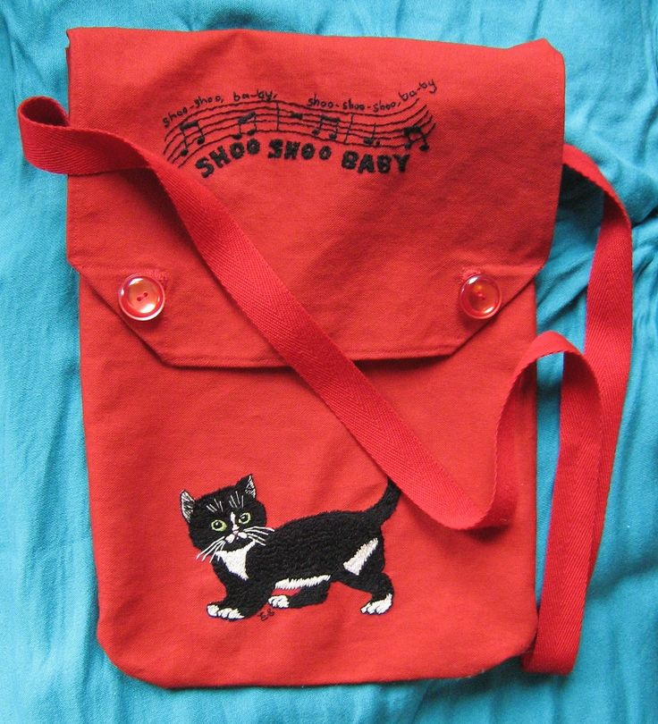 Made by Emma-Jane Stevens - An embroidered bag I constructed using an original 1940s bag as an example. I designed the embroidery myself and used the lap frame I brought from Create and Craft to make the needlework much easier on my hands. The embroidery is inspired by a rescue kitten I hand reared - her name is Sue Sue and she always comes running when she hears the 1940s song Shoo Shoo Baby.