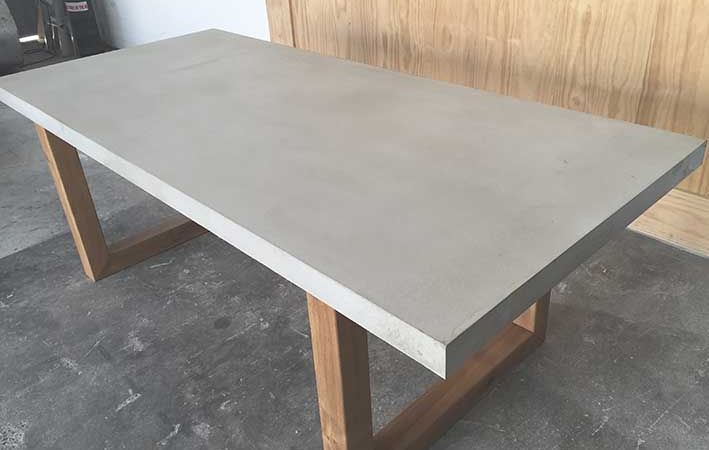 Polished Concrete Table Top w/ Solid Timber Frame  - Dimensions: 2200(L) x 1000(W) x 760mm(H) - Weight: Approx. 150kg - 100% Handmade in Australia - Shown in Meduim Grey - New Guinea Teak - Custom Colours & Sizes are available - Perfect for Indoor & Outdoor Dining - Allow 3-4 weeks for production - Australia-wide shipping