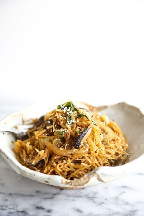 This vegetable chow mein recipe is made gluten-free by using spaghetti squash instead of noodles. It's also packed with bok choy and shitake mushrooms! A great easy weeknight meal   Feed Me Phoebe